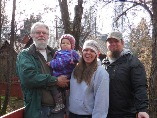 Left to right: Dennis Corp, unnamed baby, Breanna Corp and Noah Corp, all of Junction City, attend the Chinese New Year, Year of the Rooster celebration on Jan. 28 at Joss House State Historic Park in Weaverville.