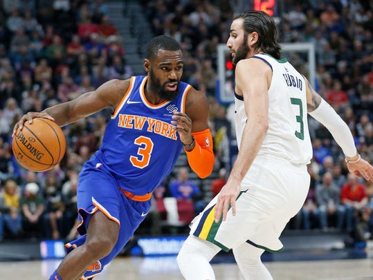 New York Knicks forward Tim Hardaway Jr. (3) drives around Utah Jazz guard Ricky Rubio (3) in the first half during an NBA basketball game Friday, Jan. 19, 2018, in Salt Lake City. (AP Photo/Rick Bowmer)