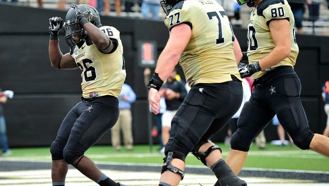 Vanderbilt running back Ralph Webb (26) scores a 4-yard touchdown in the fourth quarter Saturday that proved to be the game-winner in a 34-31 victory against UMass.