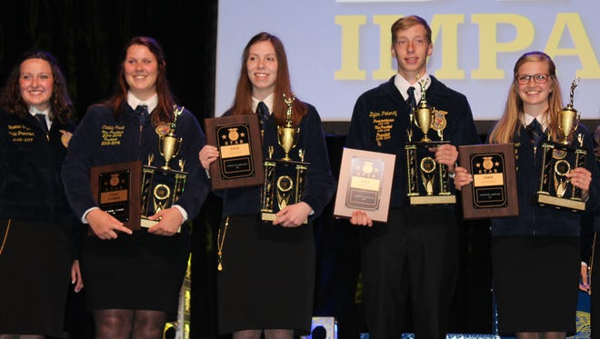 2016017 State President Brenna Bay (left) congratulates the winners of the Stars Over Wisconsin competition. Joining her are (from left) Carley Krull, Lake Mills FFA, Wisconsin Star Farmer, Amelia Hayden, Big Foot FFA, Wisconsin Star in Agriscience, Dylon Pokorny, Waupun FFA, Wisconsin Star in Agribusiness and Erica Helmer, Plymouth FFA, Wisconsin Star in Ag Placement.