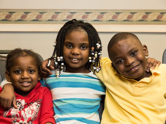 Yaya Destine, 3, left, Rochelle Louis-Jaques,7, and