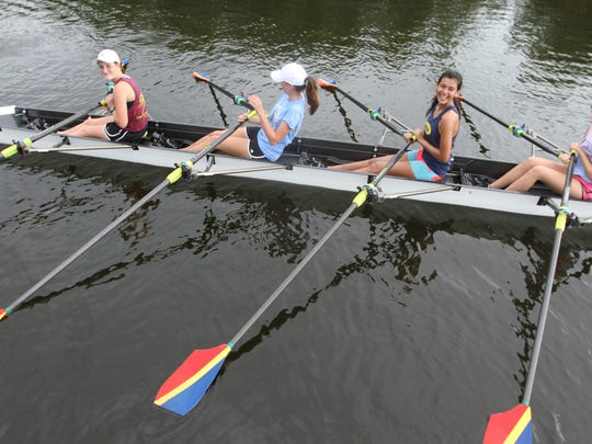Zoe Wyant, right, Valeria Contreras Anna Irving, and Madison Waddle, of the Caloosa Paddle Club, practice their technique at Cape Harbour.