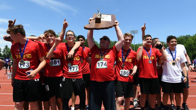 Elkhart Memorial celebrates after winning the team state championship during the Unified IHSAA track and field state finals at Robert C. Haugh Track and Field complex in Bloomington, Ind. on Saturday, May, 2, 2018.