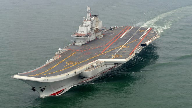 The Chinese aircraft carrier Liaoning cruises during a test on the sea last year.