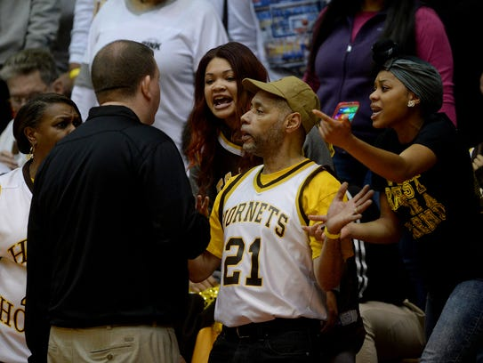 RHS assistant athletic director Jeremy Hill talks to