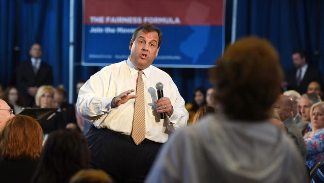 Gov. Chris Christie answers questions asked by Donna Persh , retired speech therapist from the Morris Knolls School District, during a town hall meeting to discuss his Fairness Formula school-funding plan at Packanack Lake Clubhouse, Tuesday, Oct. 4, 2016 in Wayne, N.J. The proposal is opposed by advocates for urban education because it would assign the same amount to every student, regardless of where they live and the tax base.