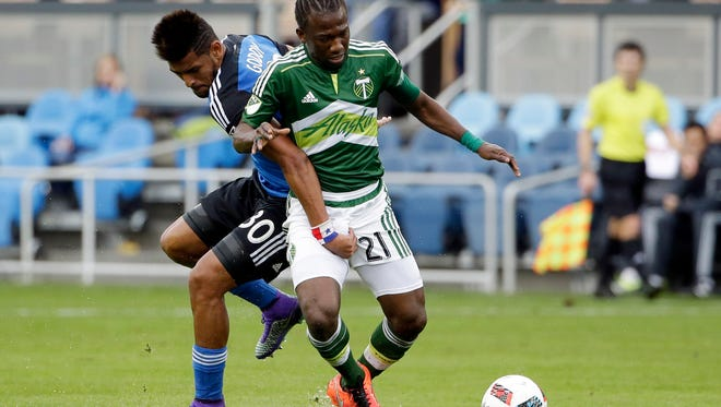 Portland Timbers midfielder Diego Chara (21) is defended by San Jose Earthquakes midfielder Anibal Godoy (30) during the first half of an MLS soccer match Sunday, March 13, 2016, in San Jose, Calif.