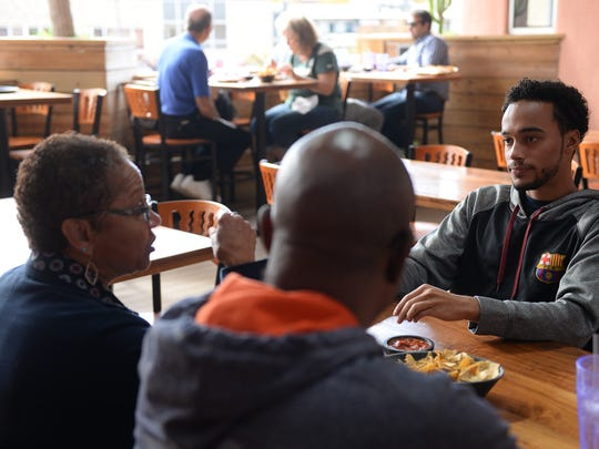 Rudy and Christine Redmond, from Southfield, enjoy lunch with their grandson and MSU student Torey Redmond at El Azteco on Oct. 11, 2016 in East Lansing.
