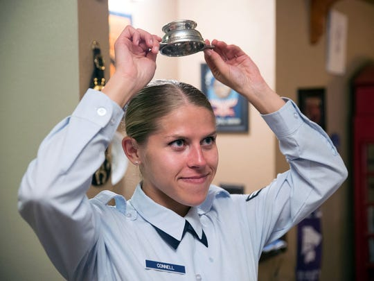 Airman Mariah Connell drank Laphroaig 10-year scotch from a Scottish quaich in a ceremonial passing of the pipes from her father Michael Connell to her. She must hold the quaich upside down over her head to show that she finished the Scotch. Michael Connel has been the only military piper in Nevada for many years and now that he's retiring, Mariah Connell will take over.