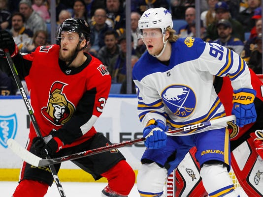 Buffalo Sabres forward Alexander Nylander (92) and Ottawa Senators defenseman Fredrik Claesson (33) battle in front of the net during the first period of an NHL hockey game, Wednesday, April 4, 2018, in Buffalo, N.Y. (AP Photo/Jeffrey T. Barnes)