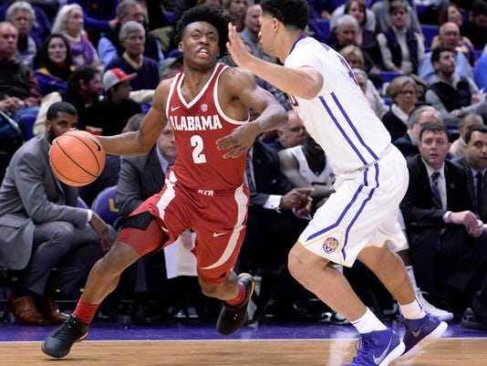 Alabama guard Collin Sexton (2) drives to the basket past LSU guard Skylar Mays during the first half of an NCAA college basketball game Saturday, Jan. 13, 2018, in Baton Rouge, La. (Hilary Scheinuk/The Advocate via AP)