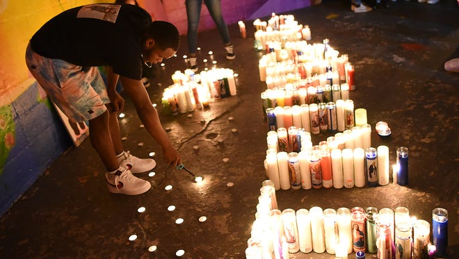 Vigil for Trinidad family at Votee Park in Teaneck on Saturday July 07, 2018. Audie Trinidad and his four daughters: Kaitlyn, 20; Danna, 17; and Melissa and Allison, 13-year-old twins, were killed in a automobile crash on Friday in Delaware. Anthony Harley-Curtis, lights candles during the vigil.