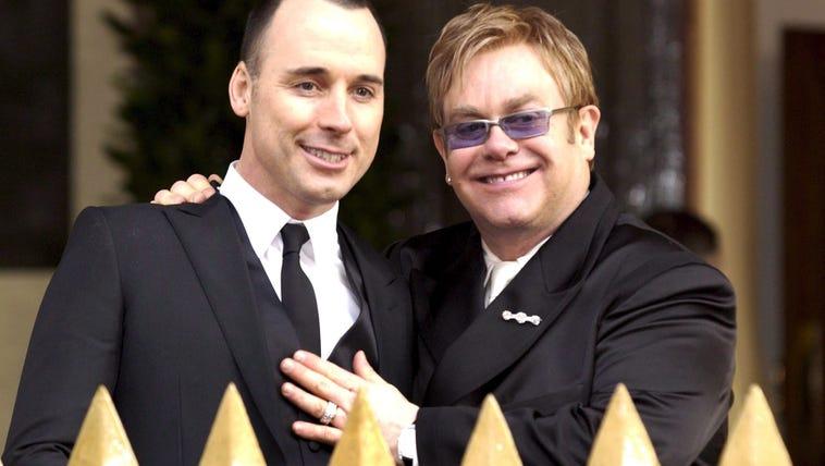 British music star Sir Elton John, right, and his partner