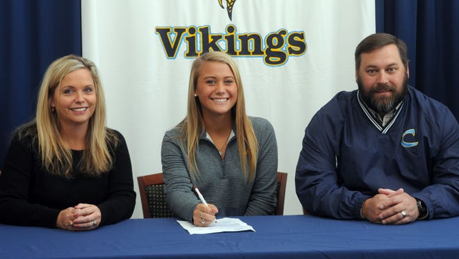 Cape Henlopen's Sydney Ostroski signs her national letter of intent to play field hockey at West Chester University.
