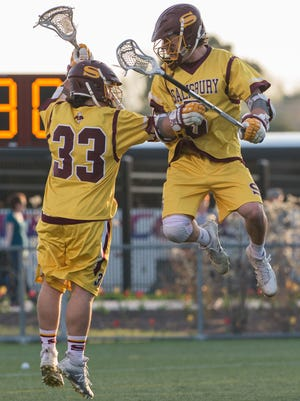 Salisbury's Carson Kalama (33) celebrates with teammate Duncan Campbell (5) after scoring a goal against York College on Wednesday, April 12, 2017.