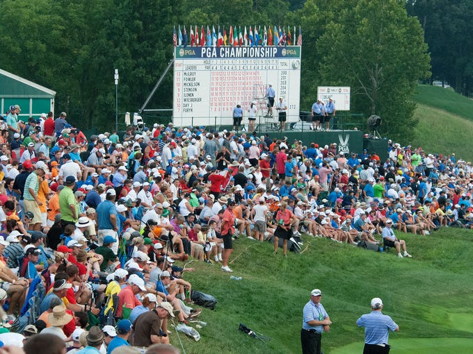 The galleries keep building around the 18th green with the leaders still two holes away.