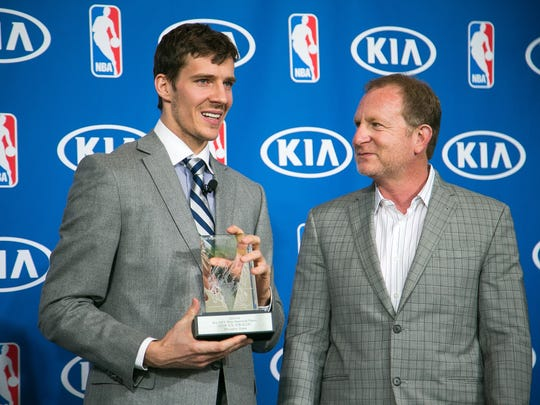 Suns guard Goran Dragic talks with owner Robert Sarver after winning the NBA's Most Improved Player of the Year Award on April 23, 2014.