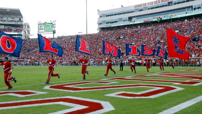 Mississippi cheerleaders celebrate a score in the second half of an NCAA college football game against Vanderbilt in Oxford, Miss., Saturday, Oct. 14, 2017. Mississippi won 57-35. (AP Photo/Rogelio V. Solis)