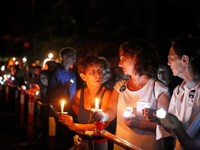 """Over a 100 New Yorkers line up in front of Gov. Andrew Cuomo's residence for a """"Candles for Clemency"""" vigil, Sept. 6, 2014 in New Castle. Supporters are urging Gov. Andrew Cuomo to grant clemency to even one of the 55,000 men and women imprisoned in New York State."""
