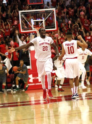 Tournament MVP Jameel Warney of Stony Brook celebrates in the closing seconds of the Seawolves' 80-74 victory over Vermont in the America East championship game at Stony Brook, N.Y. on Saturday.