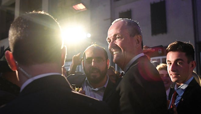 Governor-elect Phil Murphy takes photos with supporters last month after giving his victory speech at the Asbury Park Convention Hall.
