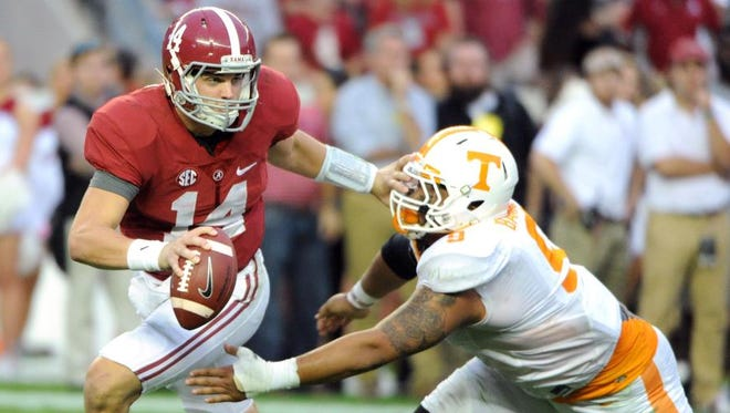 Tennessee kept pressure on Alabama's offense throughout Saturday's game, but the Crimson Tide escaped with a 19-14 victory.