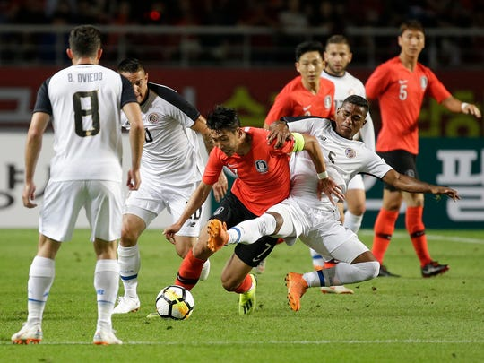 South Korea's Son Heung-min, center left, fights for the ball against Cost Rica's Allan Cruz during their friendly soccer match in Goyang, South Korea, Friday, Sept. 7, 2018. (AP Photo/Ahn Young-joon)