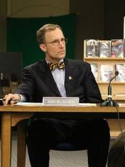 Board Directors Martin LaLonde and Steve Wisloski listen