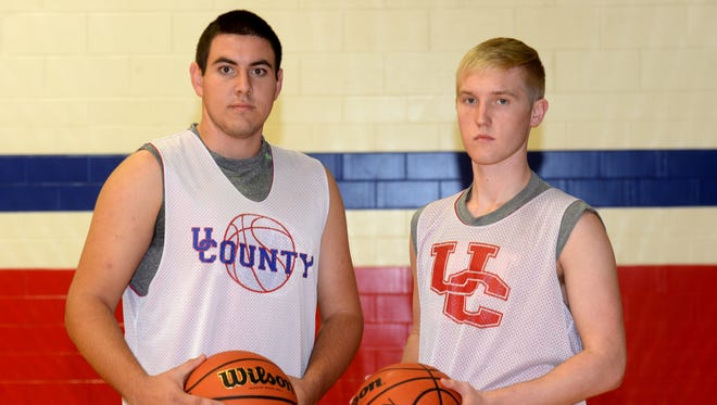 Union County High School boys basketball players Dillon Miller, left, and Logan Sanford during practice Tuesday, Nov. 17, 2015, in Liberty.