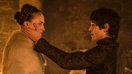 """This photo provided by courtesy of HBO shows, Sophie Turner, left, as Sansa Stark, and Iwan Rheon, as Ramsay Bolton, in a scene from season 5 of """"Game of Thrones.""""  The show airs Sundays at 9 p.m. EDT. (Helen Sloan/HBO via AP)"""