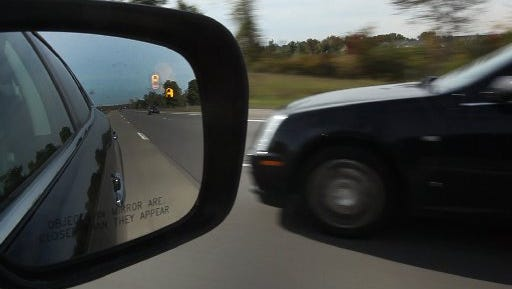 Safety technology like blind-spot detection, seen here in a 2011 Lincoln MKZ hybrid, could help prevent a third of the 33,000 traffic deaths in the U.S. each year, but a study by the Boston Consulting Group found that consumers are adopting the features very slowly.