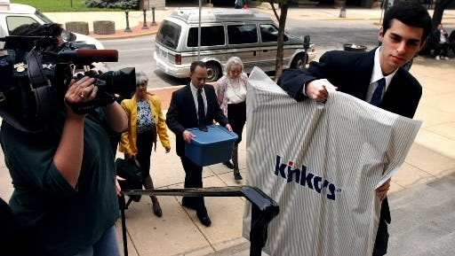 Zachary Witman, accused of killing his brother, carries documentation for his defense into the York County (Pa.) Courthouse in 2003. He was convicted and sentenced to life imprisonment.