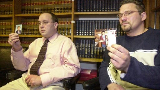 Brian Gergely, 33, right, and Kevin Hoover, 30, show old photographs of themselves during a news conference in Altoona, Pa., Thursday, Feb. 6, 2003. They said the pictures were taken during the time they allege a Roman Catholic priest sexually abused them while they were altar boys. The men, along with three others, are suing the Altoona-Johnstown diocese, about 80 miles east of Pittsburgh, Bishop Joseph Adamec, and former Bishop Joseph Hogan, claiming the church should have known about the abuse and was negligent. The Pennsylvania Attorney General's office announced a grand jury report outlining how church leaders covered up sexual abuse.