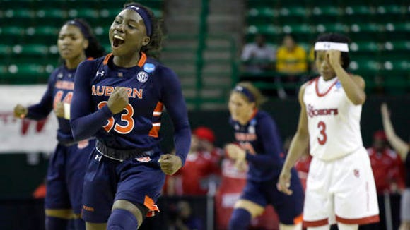 Auburn guard Janiah McKay (33) celebrates a basket against St. John's during the second half of a first-round women's college basketball game in the NCAA Tournament Friday, March 18, 2016, in Waco, Texas. (AP Photo/LM Otero)