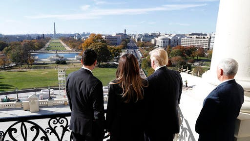 House Speaker Paul Ryan of Wis., left, shows President-elect Donald Trump, his wife Melania and Vice president-elect Mike Pence the view of the inaugural stand that is being built and Pennsylvania Avenue, from the Speaker's Balcony on Capitol Hill in Washington, Thursday, Nov. 10, 2016.