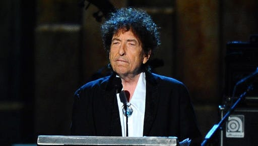 In this Feb. 6, 2015 file photo, Bob Dylan accepts the 2015 MusiCares Person of the Year award at the 2015 MusiCares Person of the Year show in Los Angeles. Dylan won the 2016 Nobel Prize for literature.