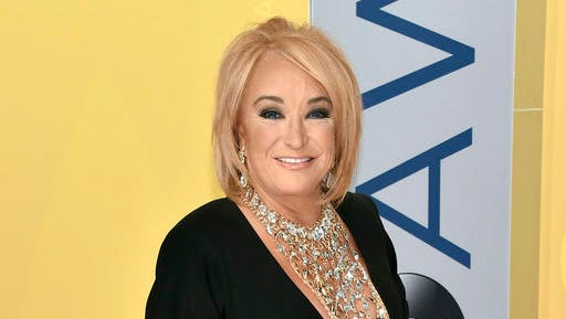 FILE - This Nov. 2, 2016 file photo shows Tanya Tucker at the 50th annual CMA Awards in Nashville, Tenn. Tucker is postponing tour dates after fracturing a vertebrae and injuring a rib during a fall while on tour. A statement from her publicist released Wednesday, Jan. 11, 2017, said Tucker was also diagnosed with bronchitis while in the hospital in Texas. The statement said she is receiving breathing treatments and physical therapy, but will not have to have surgery.