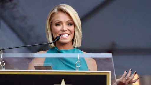 FILE - In this Oct. 12, 2015, file photo, Kelly Ripa addresses the crowd during a ceremony honoring her with a star on the Hollywood Walk of Fame in Los Angeles. Ripa, singer Wyclef Jean and soccer pro Carli Lloyd are among the 15 newest members of the New Jersey Hall of Fame, the group announced Tuesday, Jan. 17, 2017.