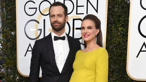 FILE - In this Jan. 8, 2017 file photo, Benjamin Millepied, left, and Natalie Portman arrive at the 74th annual Golden Globe Awards in Beverly Hills, Calif.  A representative for the Oscar-winning actress said Friday, March 3, that Portman and her husband Benjamin Millepied welcomed daughter Amalia Millepied, on Feb. 22.