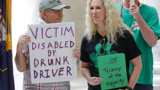 Ed Staley, left, and Tali Bruce, right, attend a rally at the Utah State Capitol Friday, March 17, 2017, in Salt Lake City. Utah's hospitality industry is urging Gov. Gary Herbert to veto a bill giving Utah the strictest DUI threshold in the country, lowering the blood alcohol limit to .05 percent, down from .08 percent.