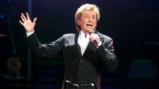 "FILE - In this March 17, 2016 file photo, Barry Manilow performs in concert during his ""One Last Time! Tour 2016"" in Hershey, Pa. The Grammy Award-winning singer of such songs as ""Mandy,"" ""I Write the Songs"" and ""Looks Like We Made It"" will appear at the next monthly ""Concert for America: Stand Up, Sing Out!"" on April 18 at The Town Hall in New York. It also will be streamed live on Facebook."