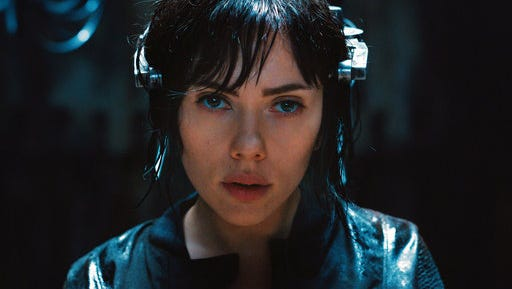 "In this image released by Paramount Pictures, Scarlett Johansson appears in a scene from, ""Ghost in the Shell."""