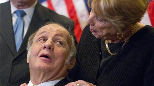 Former White House press secretary James Brady, left, who was left paralyzed in the Reagan assassination attempt, looking at his wife Sarah Brady, during a news conference on Capitol Hill in Washington marking the 30th anniversary of the shooting. A Brady family spokeswoman says Brady has died at 73.