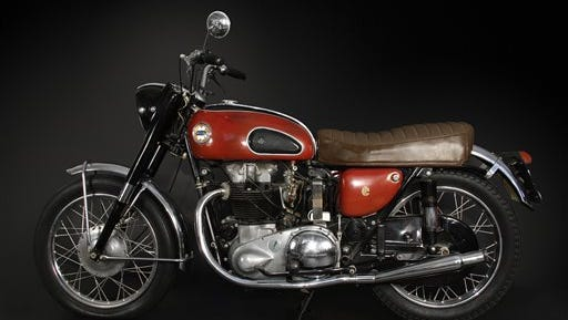 This undated image released by Guernsey?s Auction House a motorcycle belonging to Waylon Jennings. The item, which originally belonged to singer Buddy Holly, is one of many items from country singer Waylon Jennings? possessions up for auction in Phoenix. New York City-based auction house Guernsey?s is holding the sale of more than 2,000 of Jennings? belongings online at the Musical Instrument Museum in Phoenix.  Jennings, who defined the outlaw movement in country music, died Feb. 13, 2002, at 64.