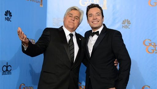 FILE - This Jan. 13, 2013 file photo shows Jay Leno, left, and Jimmy Fallon backstage at the 70th Annual Golden Globe Awards in Beverly Hills, Calif.