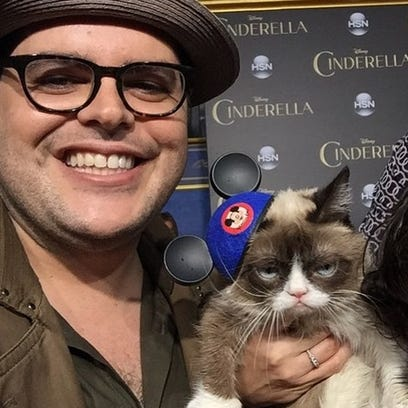 Actor Josh Gad meets Grumpy Cat at the premiere of