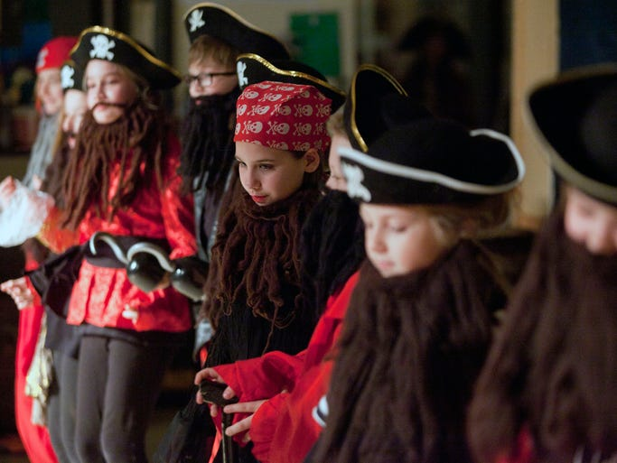 Corrina Weaver, center, and other cast members perform a scene from Lady Pirates of the Caribbean during a performance for the student body at Mt. Washington Elementary School.