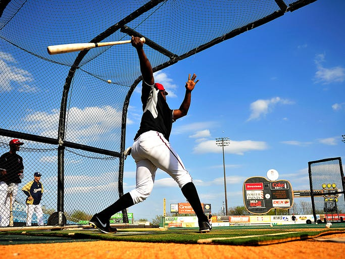 Nashville Sounds' Elian Herrera hits balls in the hitting cage before the home season opener against Omaha Storm Chasers at Greer Stadium in Nashville, Tenn., Friday, April 11, 2014.