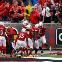 Louisville's Sheldon Rankins gets swarmed by teammates after he recovered a fumble and ran it back for touchdown.  Oct. 24 2015