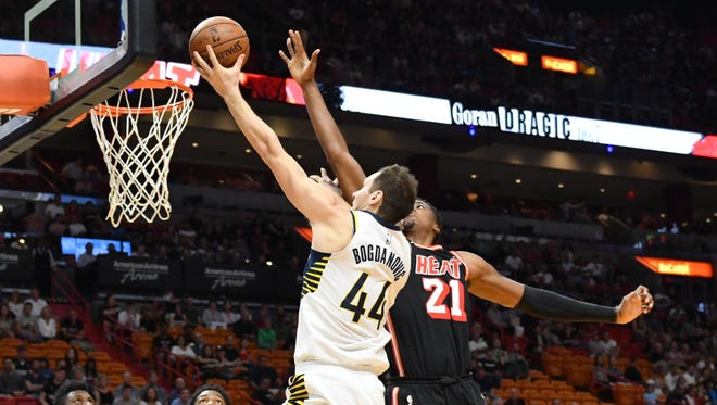 Indiana Pacers forward Bojan Bogdanovic (44) drives to the basket as Miami Heat center Hassan Whiteside (21) defend the play during the first half at American Airlines Arena.
